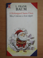 Lyman Frank Baum - Mos Craciun a fost rapit (editie bilingva)
